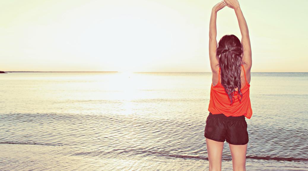 Girl enjoying sunset on the beach